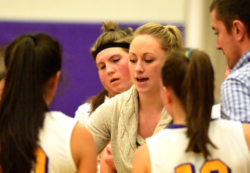 Boulder's Emily Glen draws a play in the huddle during the Panthers' game against Arvada West on Monday, Dec. 17, at Boulder High.
