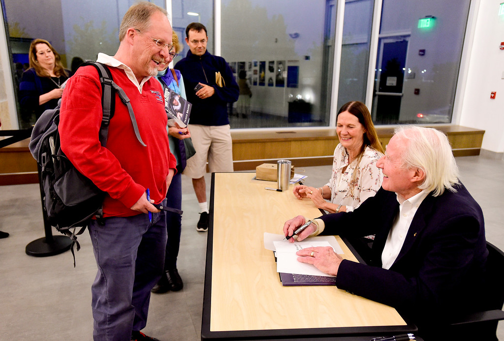 """. Vance Brand, former NASA astronaut and Longmont High School graduate, talks with Lonnie Hilkemeier, a flight instructor from Boulder, left, while signing copies of his memoir \""""Flying Higher and Faster\"""" at the Longmont Museum and Cultural Center on Wednesday. More photos: TimesCall.com. Matthew Jonas/Staff Photographer May 17, 2017"""