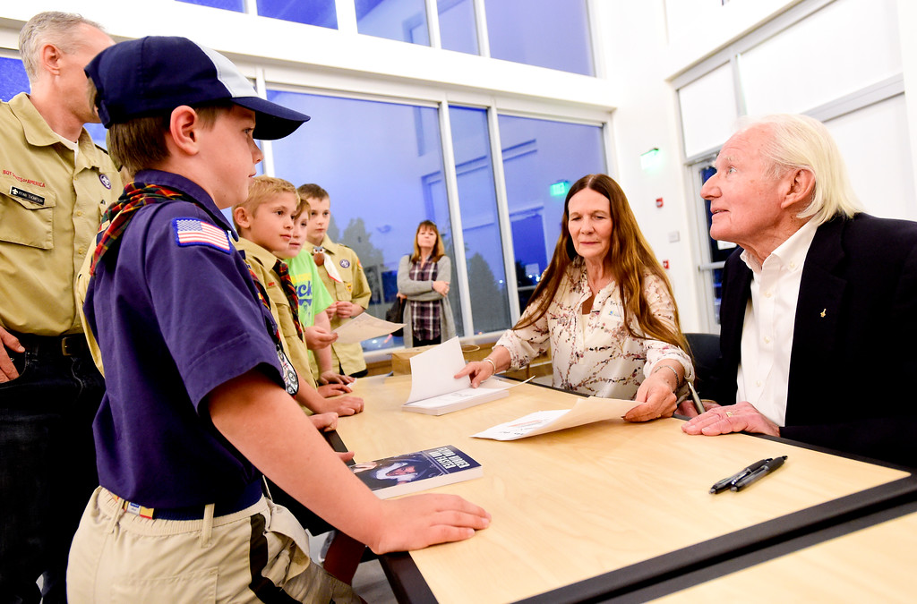 . Vance Brand, former NASA astronaut and Longmont High School graduate, talks with a group of Cub Scouts from Pack 161 and Pack 673 as Brand\'s wife Beverly looks after a presentation at the Longmont Museum and Cultural Center on Wednesday. More photos: TimesCall.com. Matthew Jonas/Staff Photographer May 17, 2017