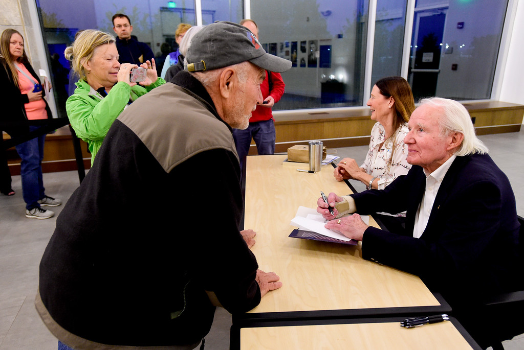 . Vance Brand, former NASA astronaut and Longmont High School graduate, talks with Bill Ingalls, of Boulder, while singing his book at the Longmont Museum and Cultural Center on Wednesday. More photos: TimesCall.com. Matthew Jonas/Staff Photographer May 17, 2017