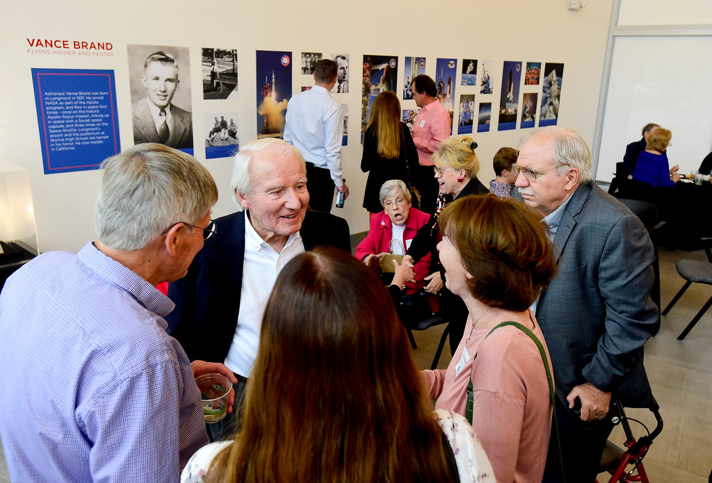 . Vance Brand, former NASA astronaut and Longmont High School graduate, talks with Jack Shaffer, left, and Keyo Shaffer, right, as Brand\'s wife Beverly looks on before a presentation at the Longmont Museum and Cultural Center on Wednesday. More photos: TimesCall.com. Matthew Jonas/Staff Photographer May 17, 2017
