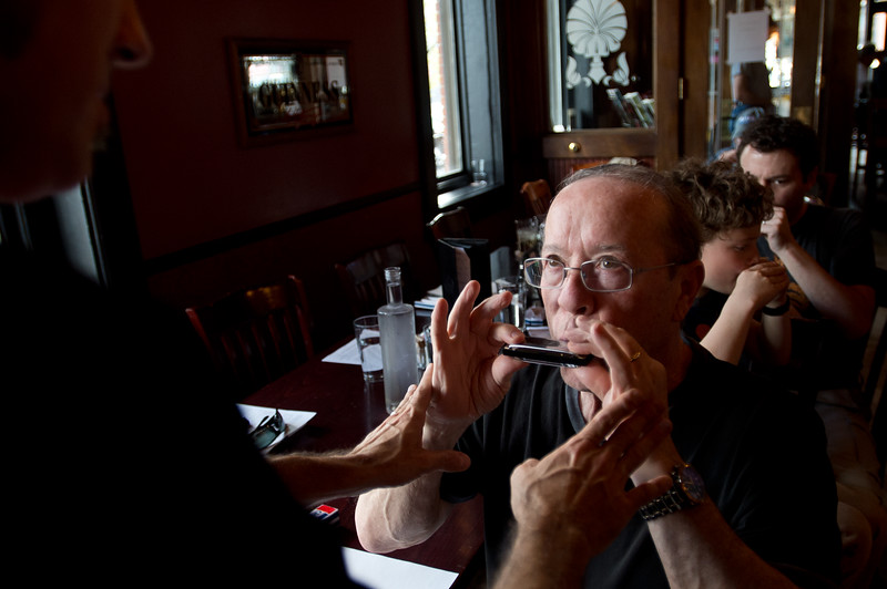 "Hamilton Loomis teaches proper form to Dan Wisecup during the ""Beginner Blues Harmonica Workshop"" at Dickens Tavern in Longmont on Saturday. <br /> More photos:  <a href=""http://www.dailycamera.com"">http://www.dailycamera.com</a><br /> Autumn Parry/Staff Photographer<br /> April 23, 2016"