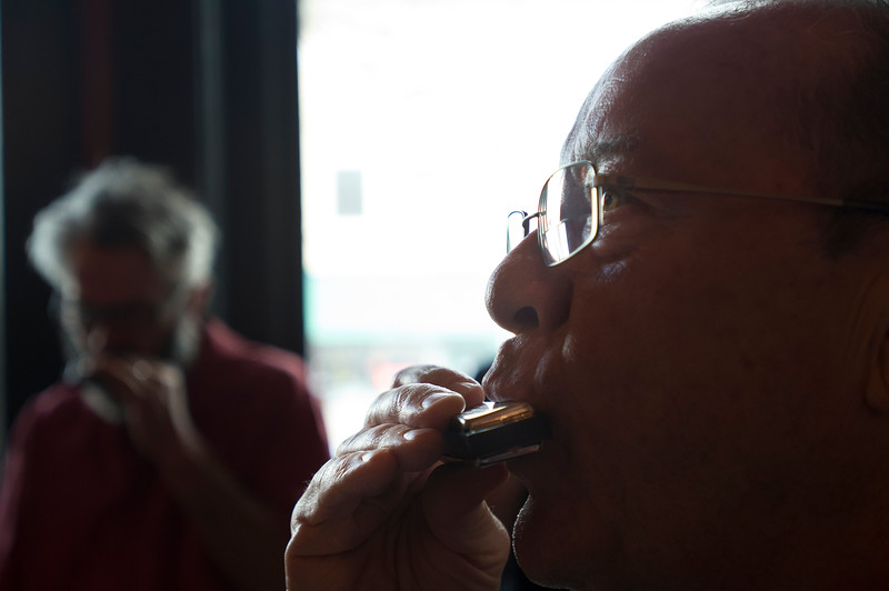 "Dan Wisecup practices the harmonica during a two-day beginners workshop at Dickens Tavern in Longmont on Saturday.<br /> More photos:  <a href=""http://www.dailycamera.com"">http://www.dailycamera.com</a><br /> Autumn Parry/Staff Photographer<br /> April 23, 2016"