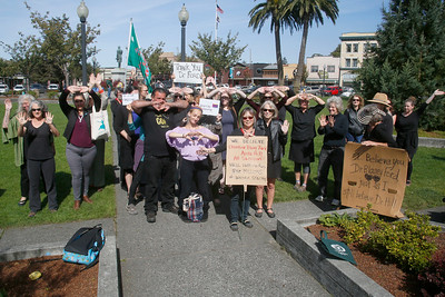 About 40 women and a few men stand in solidarity with Christine Blasey Ford on Arcata Plaza on Thursday shortly after she spoke in the U.S Senate about her sexual assault allegations against Supreme Court Justice nominee Brett Kavanaugh. (Shaun Walker -- The Times-Standard)