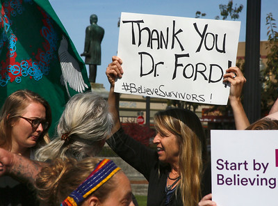 Romi Hitchcock-Tinseth of Arcata holds a sign as she stands with about 40 other women and a few men in solidarity with Christine Blasey Ford on Arcata Plaza on Thursday shortly after she spoke in the U.S Senate about her sexual assault allegations against Supreme Court Justice nominee Brett Kavanaugh. (Shaun Walker -- The Times-Standard)