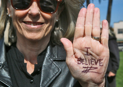 Tammie Colwell of Arcata shows her hand message as she stands with about 40 other women and a few men in solidarity with Christine Blasey Ford on Arcata Plaza on Thursday shortly after she spoke in the U.S Senate about her sexual assault allegations against Supreme Court Justice nominee Brett Kavanaugh. (Shaun Walker -- The Times-Standard)