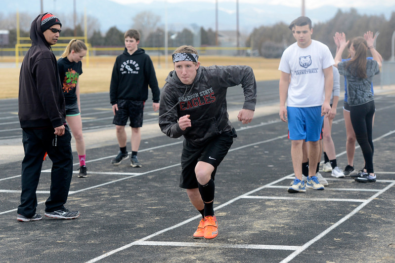 Berthoud senior Brock Voth works on the long jump during a practice March 1, 2018 at Berthoud High School. (Sean Star/Loveland Reporter-Herald)