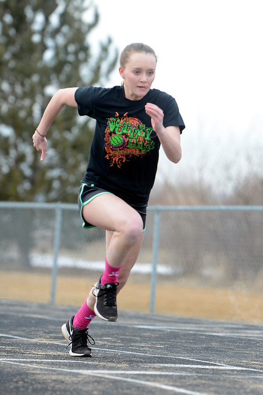 . Berthoud senior Sophia Visger starts her run-up while working on the long jump during practice on March 1 at Berthoud High School. (Sean Star/Loveland Reporter-Herald)
