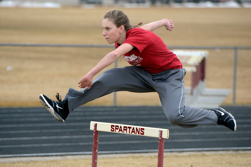 Berthoud senior Samantha Mulder clears a hurdle during a March 1, 2018 practice at Berthoud High School. (Sean Star/Loveland Reporter-Herald)