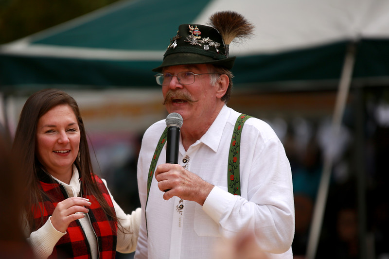 Ron Gehauf of Colorado German Dancers shows Kara Jennen the ropes of German dancing at Fickle Park during Berthoud's Oktoberfest on Oct. 6, 2018 in Berthoud.<br /> Photo by Taelyn Livingston/ Loveland Reporter-Herald