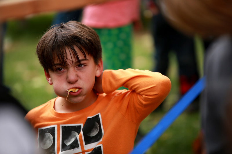 Zander Perez chomps down a pretzel at Berthoud's Oktoberfest for the pretzel-eating contest which he received first place for on Oct. 6, 2018 at Fickle Park in Berthoud.<br /> Photo by Taelyn Livingston/ Loveland Reporter-Herald