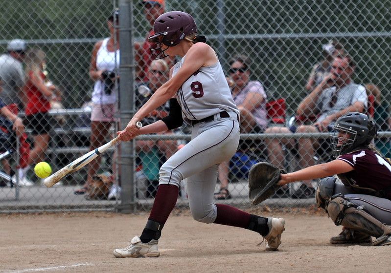 Berthoud senior Sedona Cook throws out a hit against Golden during the Berthoud Spartan Classic on Saturday Sept. 9, 2017 at the Barnes Complex. (Cris Tiller / Loveland Reporter-Herald)