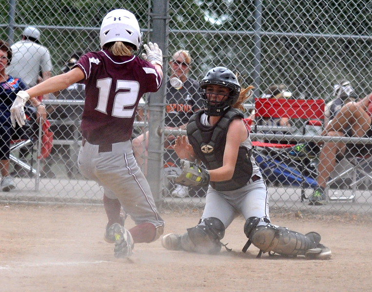 Berthoud catcher Madi Laib corrals the ball as Golden's  Cassidy Paulson slides into home during the Berthoud Spartan Classic on Saturday Sept. 9, 2017 at the Barnes Complex. (Cris Tiller / Loveland Reporter-Herald)