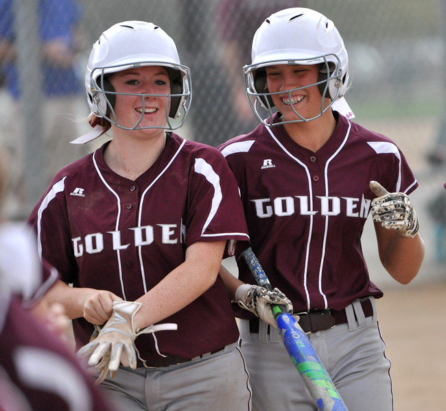 Golden sophomore Makenzie Middleton, right, smiles after hitting a home run against Berthoud during the Berthoud Spartan Classic on Saturday Sept. 9, 2017 at the Barnes Complex. (Cris Tiller / Loveland Reporter-Herald)