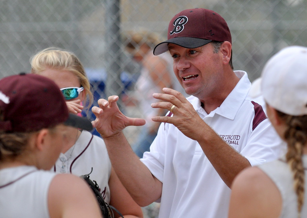 . Berthoud head coach Buddy Kouns fires up his players between innings during the Berthoud Spartan Classic on Saturday Sept. 9, 2017 at the Barnes Complex. (Cris Tiller / Loveland Reporter-Herald)