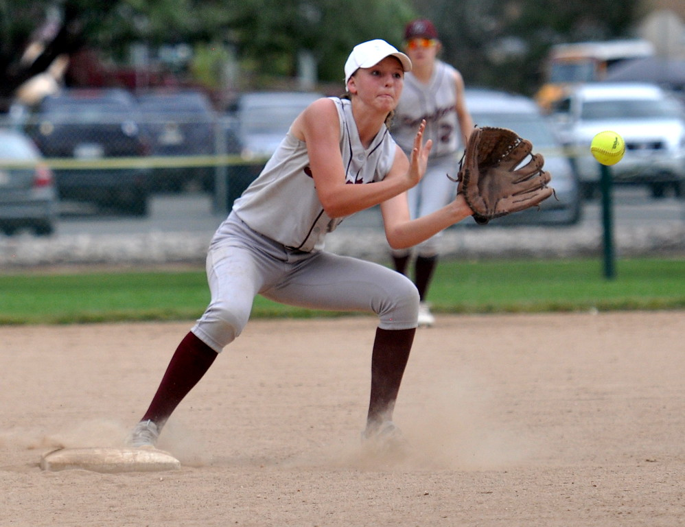 . Berthoud second baseman Delaney Fouts catches a throw to second for an out against Golden during the Berthoud Spartan Classic on Saturday Sept. 9, 2017 at the Barnes Complex. (Cris Tiller / Loveland Reporter-Herald)