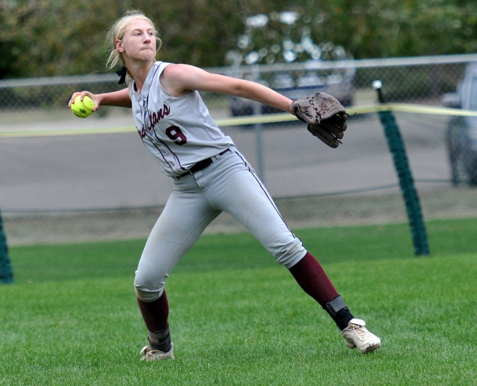 . Berthoud left fielder Sedona Cook makes a throw against Golden during the Berthoud Spartan Classic on Saturday Sept. 9, 2017 at the Barnes Complex. (Cris Tiller / Loveland Reporter-Herald)