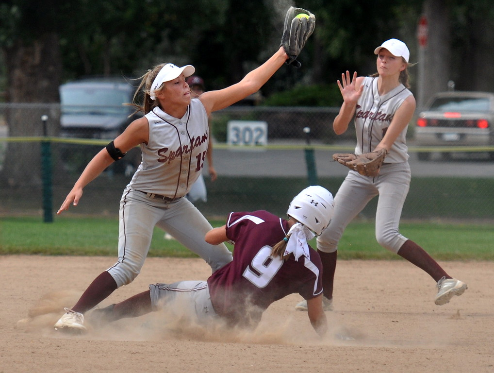 . Berthoud shortstop Addison Spears, left, makes an out at second base as Golden\'s Makayla Middleton slides into the bag during the Berthoud Spartan Classic on Saturday Sept. 9, 2017 at the Barnes Complex. (Cris Tiller / Loveland Reporter-Herald)