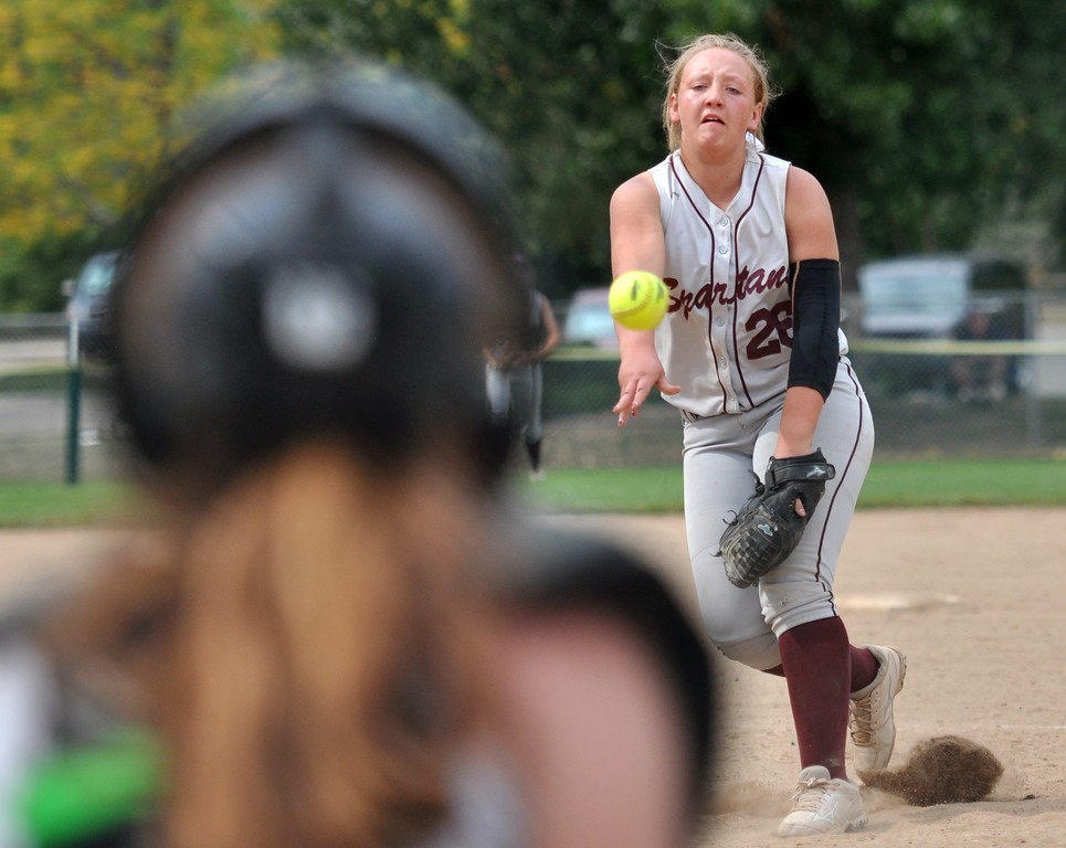 . Berthoud pitcher Natalie Fisher throws a strike against Golden during the Berthoud Spartan Classic on Saturday Sept. 9, 2017 at the Barnes Complex. (Cris Tiller / Loveland Reporter-Herald)
