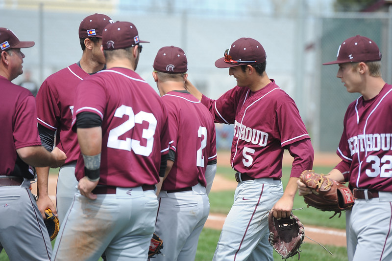 Members of the Berthoud baseball team congratulate Chris DeSousa (5) during a game Saturday, May 5, 2018 at Windsor. (Sean Star/Loveland Reporter-Herald)