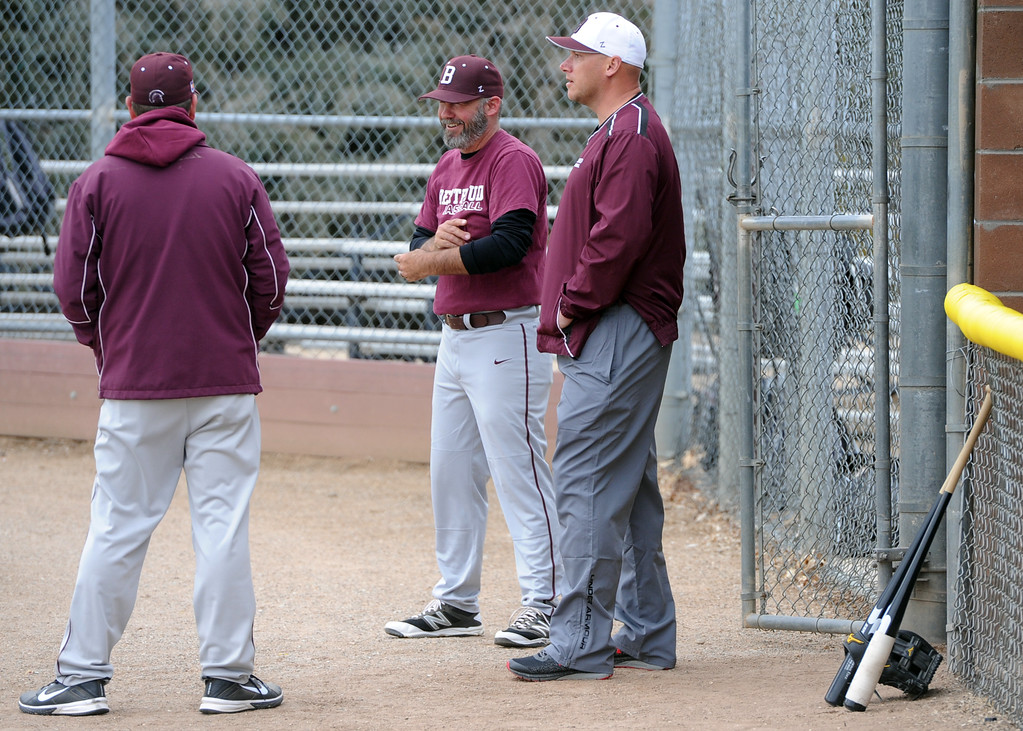 . Members of the Berthoud baseball coaching staff chat during a practice Wednesday, April 4, 2018 at Berthoud High School. (Sean Star/Loveland Reporter-Herald)