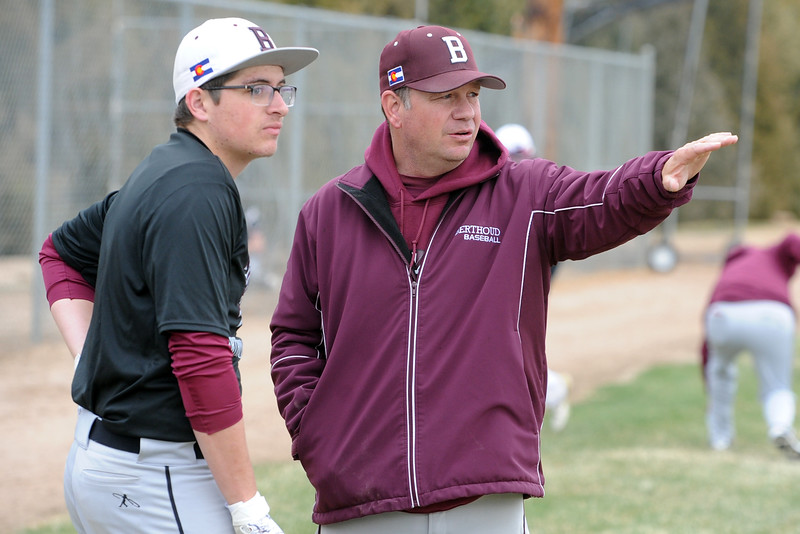 Berthoud coach Buddy Kouns talks with Braden Pickett during a practice April 4, 2018 at Berthoud High School. (Sean Star/Loveland Reporter-Herald)