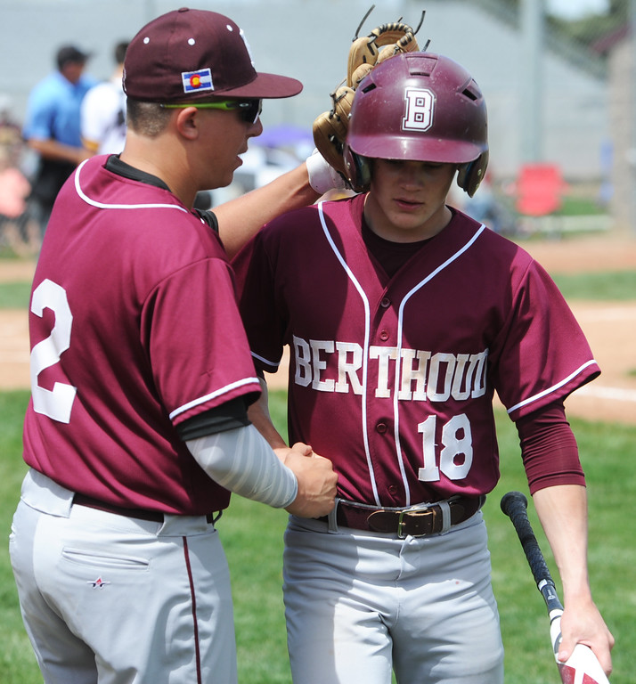 . Berthoud\'s Brent Fowler, left, congratulates teammate Ben Hardy after scoring a run during the Spartans\' game Saturday at Windsor. (Sean Star/Loveland Reporter-Herald)