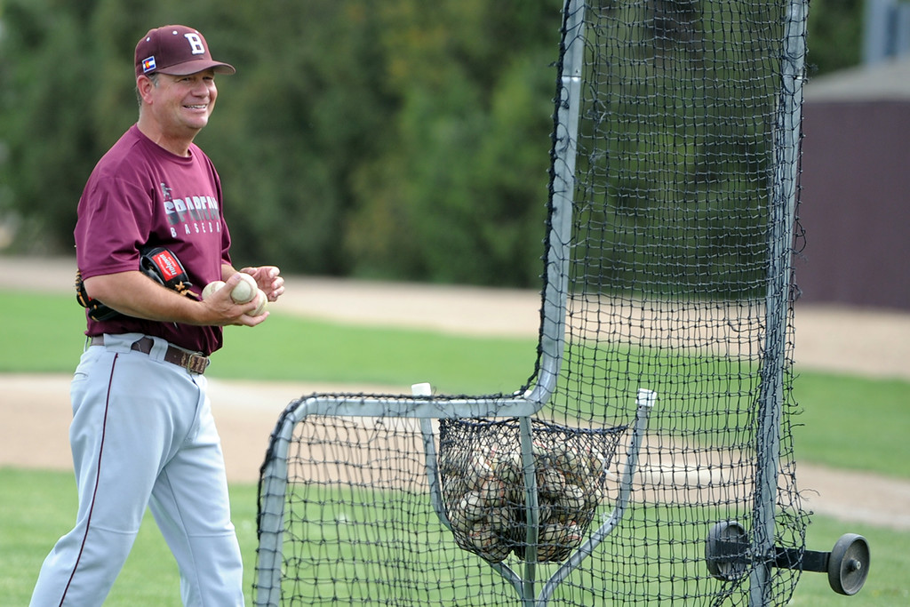 . Berthoud coach Buddy Kouns shares a laugh during a practice May 9, 2018 at Berthoud High School. (Sean Star/Loveland Reporter-Herald)