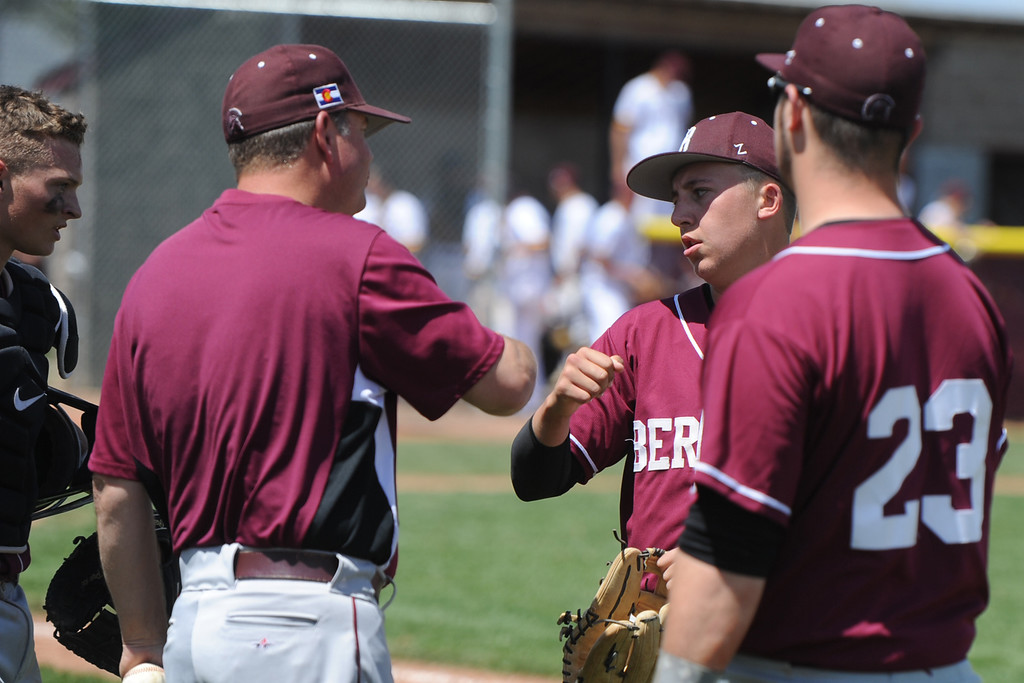 . Coach Buddy Kouns, fist bumps Brent Fowler during Berthoud\'s game May 5 at Windsor. (Sean Star/Loveland Reporter-Herald)