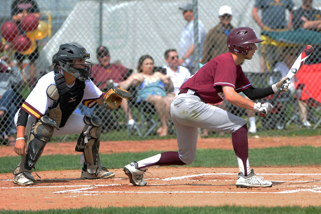 . Berthoud\'s Colin DeVore squares to bunt during a game Saturday, May 5, 2018 at Windsor. (Sean Star/Loveland Reporter-Herald)