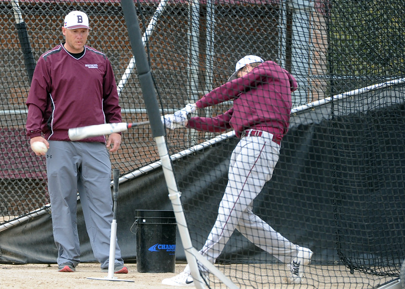 Assistant coach Clint Barmes watches as a member of the Berthoud baseball team takes a cut during a practice Wednesday, April 4, 2018 at Berthoud High School. (Sean Star/Loveland Reporter-Herald)