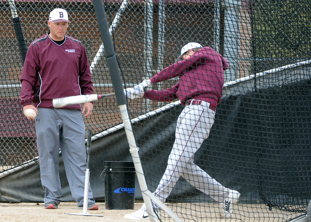 . Assistant coach Clint Barmes watches as a member of the Berthoud baseball team takes a cut during a practice Wednesday, April 4, 2018 at Berthoud High School. (Sean Star/Loveland Reporter-Herald)