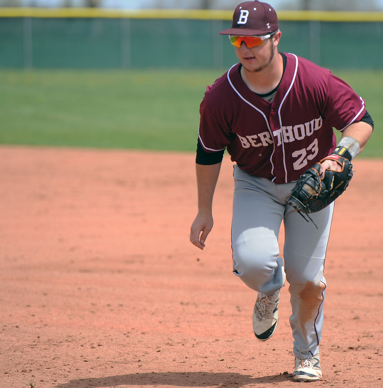 . Berthoud first baseman C.J. Balliet trots to the bag for a force out during a game May 5 at Windsor. (Sean Star/Loveland Reporter-Herald)