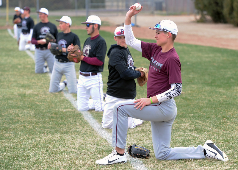 Members of the Berthoud High School baseball team warm up for practice on Wednesday, April 4, 2018. (Sean Star/Loveland Reporter-Herald)