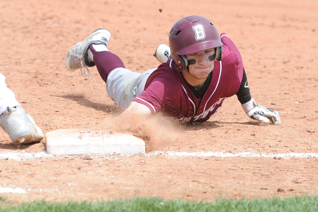. Berthoud\'s Colin DeVore dives back to first base on a pickoff attempt during a game Saturday, May 5, 2018 at Windsor. (Sean Star/Loveland Reporter-Herald)