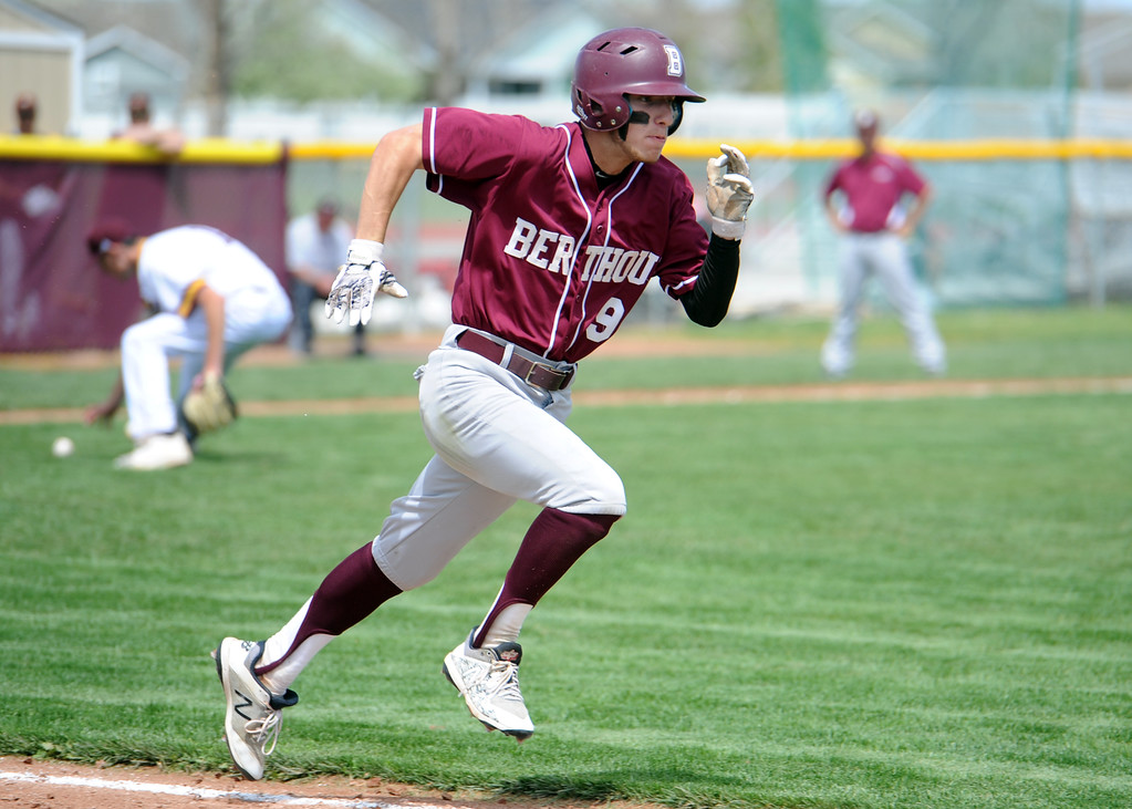 . Berthoud\'s Colin DeVore legs out a bunt single during the Spartans\' game at Windsor on Saturday. (Sean Star/Loveland Reporter-Herald)