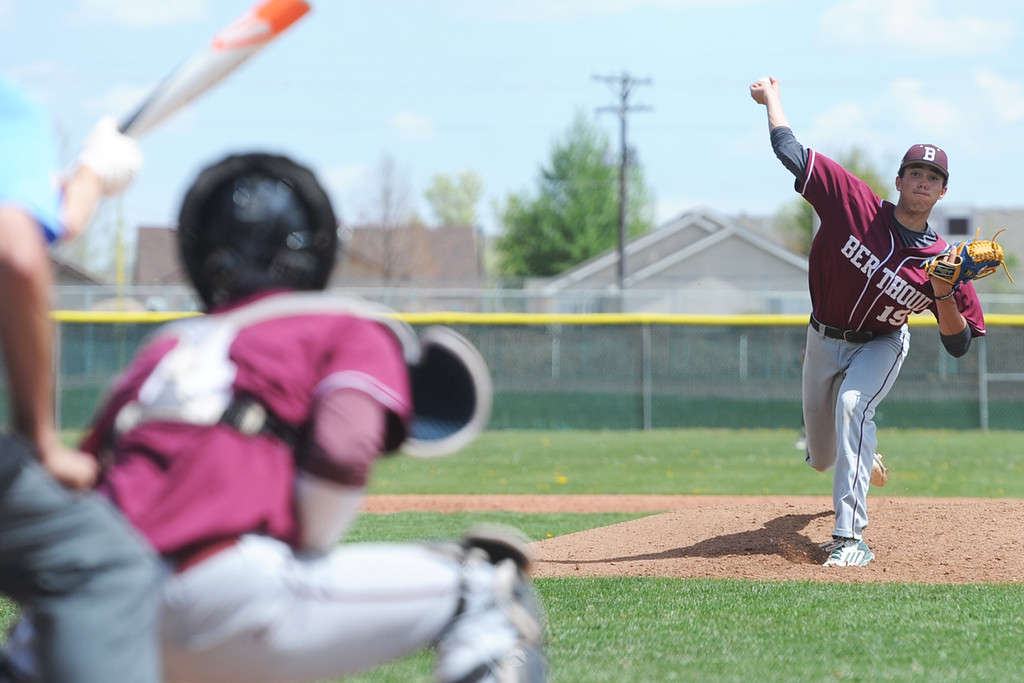 . Berthoud pitcher Quinn Oliver delivers a pitch to catcher Hunter Pearce during the Spartans\' game at Windsor on Saturday. (Sean Star/Loveland Reporter-Herald)