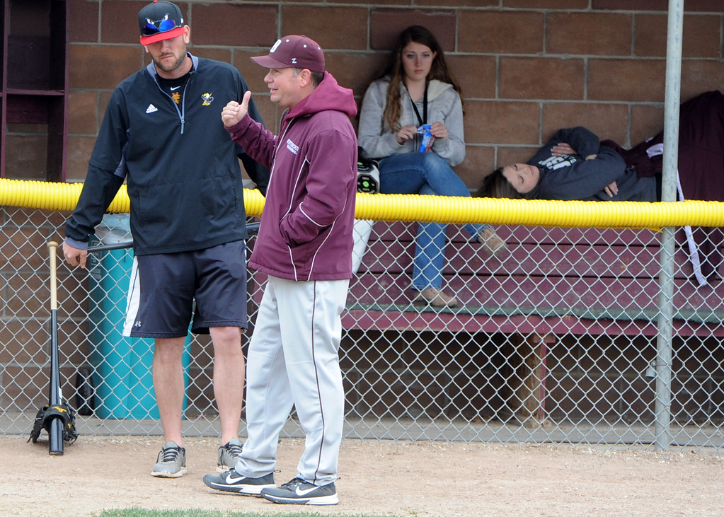 . Berthoud baseball head coach Buddy Kouns talks with assistant Sean Lydon, left, during a practice Wednesday, April 4, 2018 at Berthoud High School. (Sean Star/Loveland Reporter-Herald)