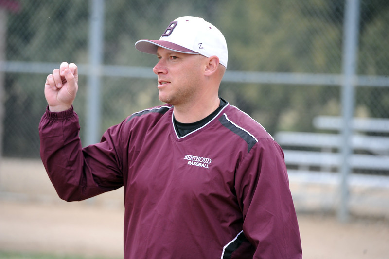 Berthoud assistant coach Clint Barmes chats with other members of the Spartans' coaching staff before a practice Wednesday, April 4, 2018 at Berthoud High School. (Sean Star/Loveland Reporter-Herald)