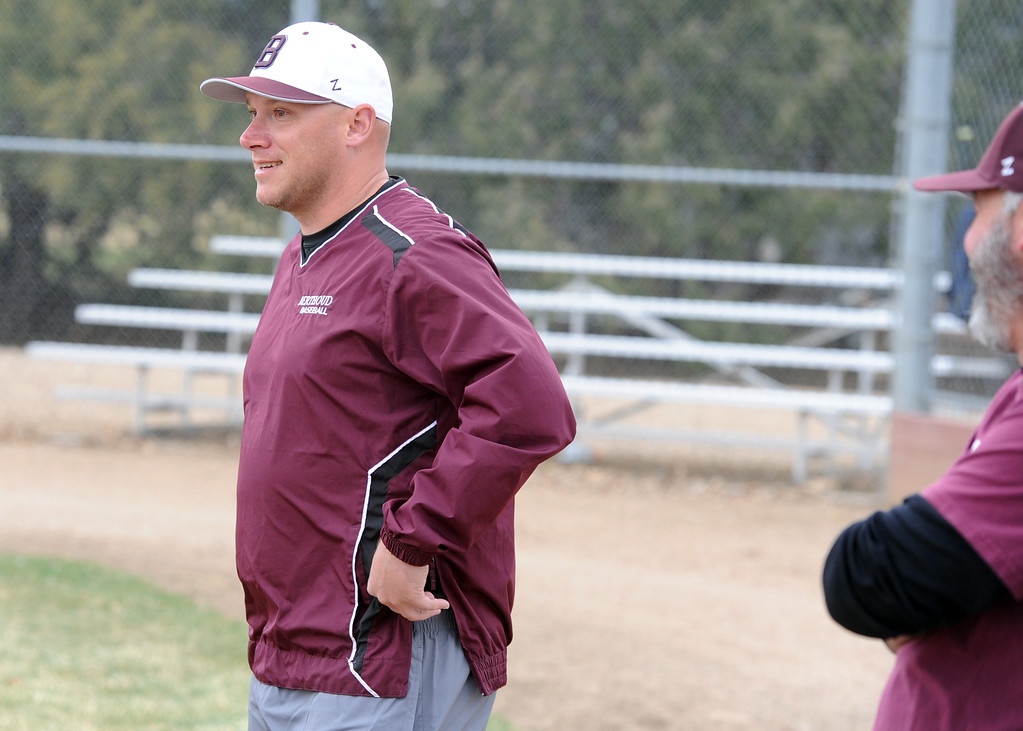 . Berthoud assistant coach Clint Barmes chats with other members of the Spartans\' coaching staff before a practice Wednesday, April 4, 2018 at Berthoud High School. (Sean Star/Loveland Reporter-Herald)