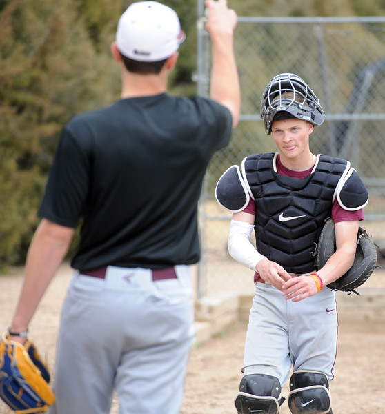 Berthoud catcher Hunter Pearce talks with pitcher Quinn Oliver during a practice March 4, 2018 at Berthoud High School. (Sean Star/Loveland Reporter-Herald)