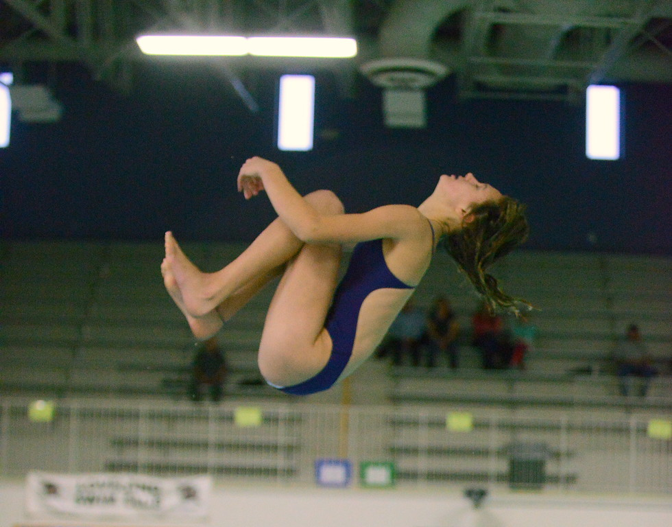 . Mountain View diver Laurene Powell starts to come out of her tuck during Thursday\'s triangular with Berthoud and Holyoke at the Mountain View Aquatic Center. (Mike Brohard/Loveland Reporter-Herald)