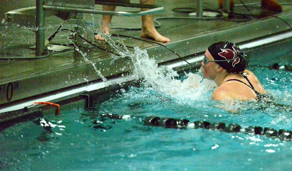 . Berthoud\'s Abby Dodd sends water flying at the finish of her 100-yard freestyle during Thursday\'s triangular with Mountain View and Holyoke at the Mountain View Aquatic Center. (Mike Brohard/Loveland Reporter-Herald)
