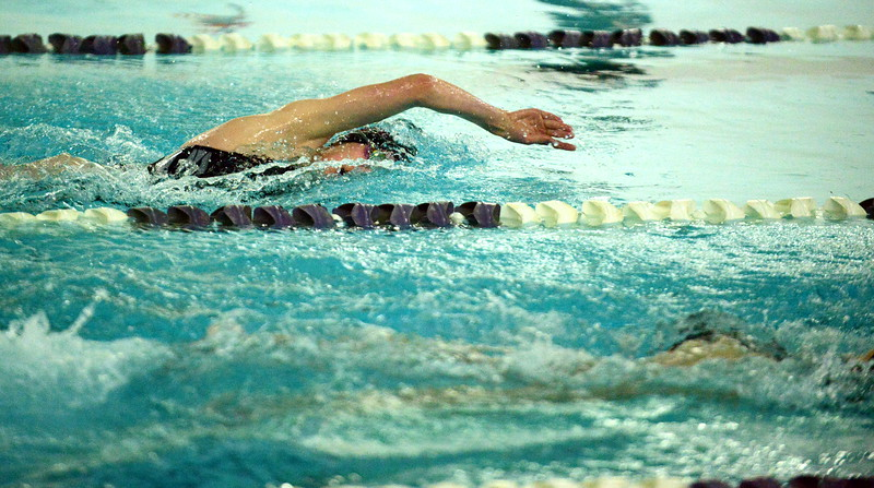 Berthoud's Emma Tartaglia swims to a second-place finish in the 200-yard freestyle during Thursday's triangular with Mountain View and Holyoke at the Mountain View Aquatic Center. (Mike Brohard/Loveland Reporter-Herald)