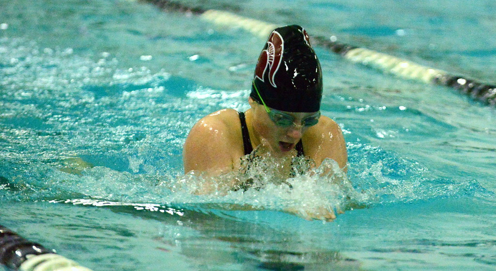 . Berthoud\'s Sydney Mong competes in the 100-yard breaststroke during Thursday\'s triangular with Mountain View and Holyoke at the Mountain View Aquatic Center. (Mike Brohard/Loveland Reporter-Herald)