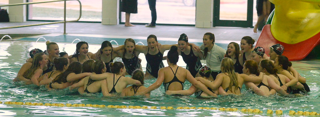 . Berthoud\'s swim team does its pre-meet cheer at Thursday\'s triangular with Mountain View and Holyoke at the Mountain View Aquatics Center. (Mike Brohard/Loveland Reporter-Herald)