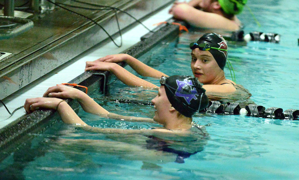 . Berthoud\'s Kristina Ball (right) chats with Mountain View\'s Tasha Reichhardt at the end of the 500-yard freestyle during Thursday\'s triangular with Holyoke at the Mountain View Aquatic Center. Ball won the race with a state-qualifying time of 6:00.66. (Mike Brohard/Loveland Reporter-Herald)