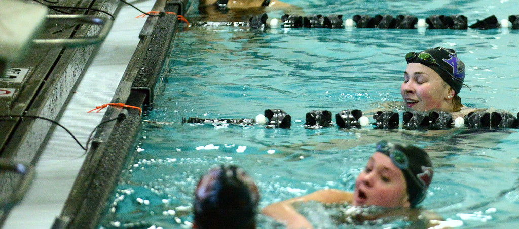 . Mountain View\'s Grace Peterson (top) has a look of relief after winning the 50-yard freestyle by hitting the state qualifying time exactly with a 26.70 during Thursday\'s triangular with Berthoud and Holyoke at the Mountain View Aquatic Center. (Mike Brohard/Loveland Reporter-Herald)