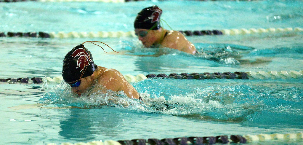 . Berthoud\'s Jamie Dellwardt gets out in front of teammate Arika Beard in the 200-medley relay during Thursday\'s triangular with Mountain View and Holyoke at the Mountain View Aquatic Center. (Mike Brohard/Loveland Reporter-Herald)