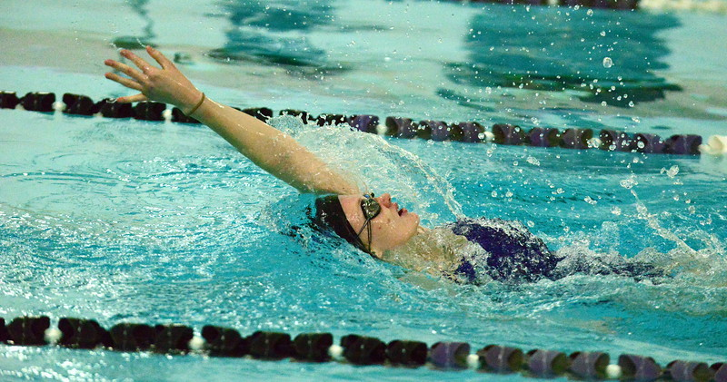 Mountain View's Tasha Reichhardt stretches out her stroke on her way to winning the 100-yard backstroke during Thursday's triangular with Berthoud and Holyoke at the Mountain View Aquatic Center. (Mike Brohard/Loveland Reporter-Herald)